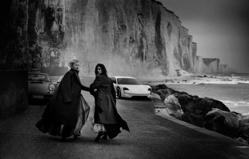 70 years of the Porsche sports car à la Peter Lindbergh: The fashion and celebrity photographer shoots the iconic 911 sports car and the concept study of the first electric vehicle from Porsche, the Mission E, on the beach in Ault, northern France