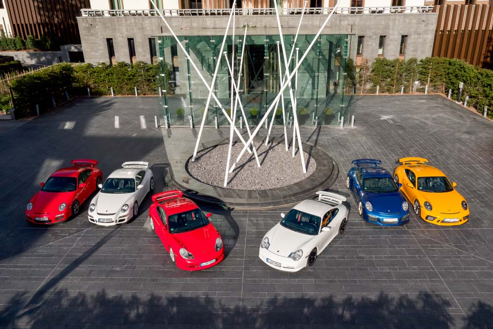 All six generations of the Porsche 911 GT3 (f.r.: 997.2, 997.1, 996.1, 996.2, 991.1, 991.2)