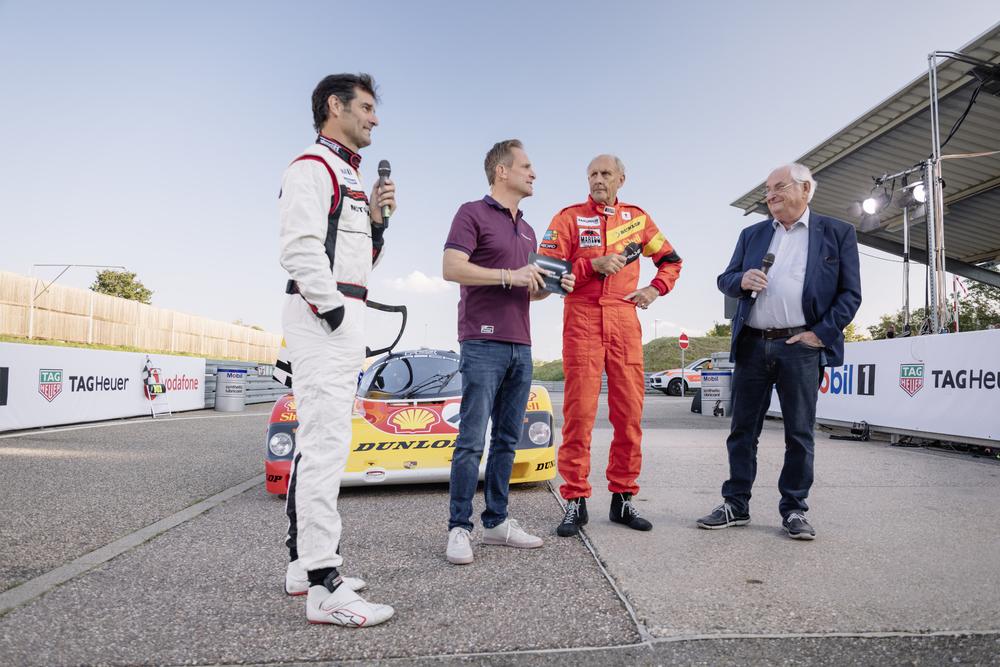 From-left-to-right-Mark-Webber-presenter-Matthias-Malmedie-Hans-Joachim-Stuck-and-Norbert-Singer.