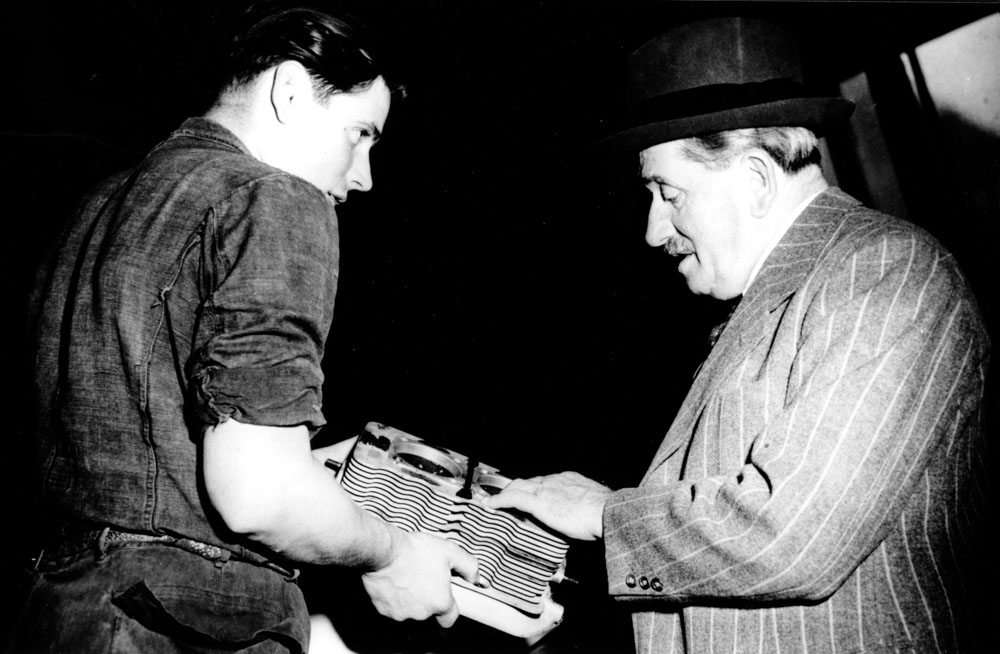 December 1949: Herbert Linge (left) shows Ferdinand Porsche the first cylinder block produced in Stuttgart for the early 356.